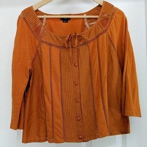 Anthro's Deletta orange screened striped top